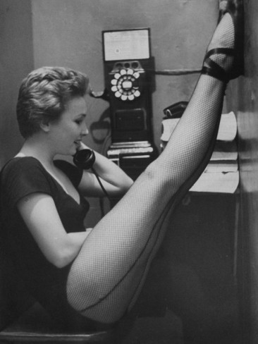 gordon-parks-dancer-mary-ellen-terry-talking-with-her-legs-up-in-telephone-booth